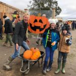 Family having fun at Farmer Copleys Pumpkin Festival