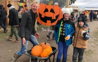Family having fun at Farmer Copleys Pumpkin Festival