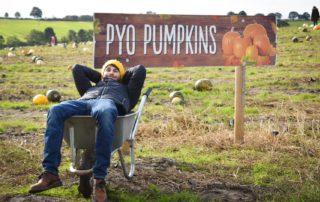 Man in wheelbarrow at Farmer Copleys Pumpkin Festival.