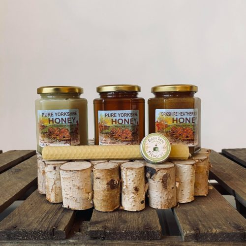 A hamper containing a variety of honey, a candle and some balm from Farmer Copleys farm shop.